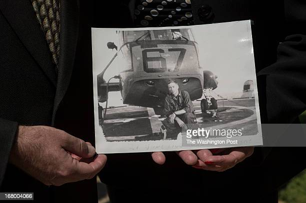 Shannon McGrane and his mom Karen Fischer show off a picture of Aviation Antisubmarine Warfare Technician Donald McGrane one of four missing US Navy...