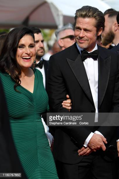 Shannon McIntosh and Brad Pitt attends the screening of Once Upon A Time In Hollywood during the 72nd annual Cannes Film Festival on May 21 2019 in...