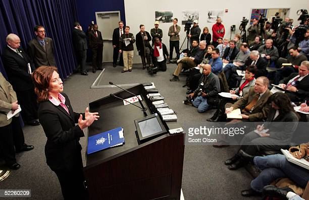 Shannon Metzker of the US Marshals' office speaks to the media during a press conference of Michael Lefkow and Donna Humphrey the husband and mother...