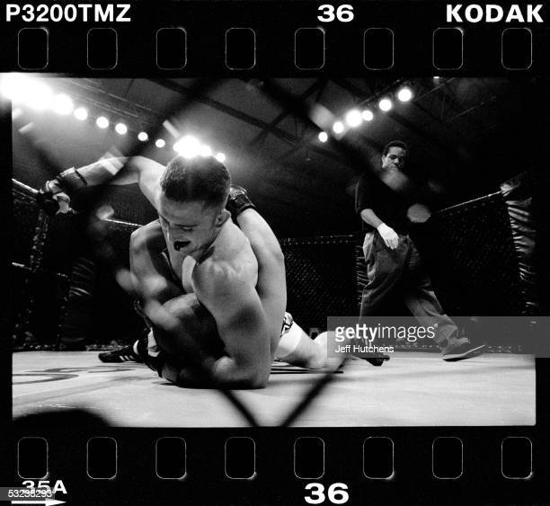 Shannon Sams punches Ceasar Gutierrez in the face during the first round of their mixed martial arts fight in the Gladiator Challenge cage at Colusa...