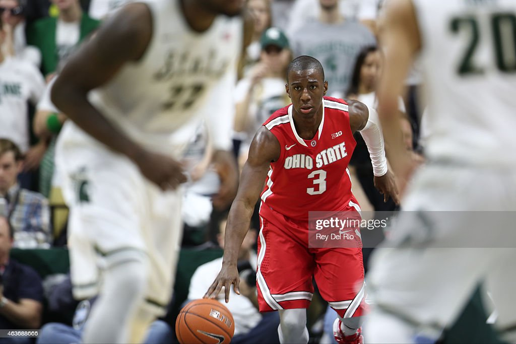 Shannon Scott #3 of the Ohio State Buckeyes brings the ball up the court during the second half against the Michigan State Spartans at the Breslin Center on February 14, 2015 in East Lansing, Michigan.