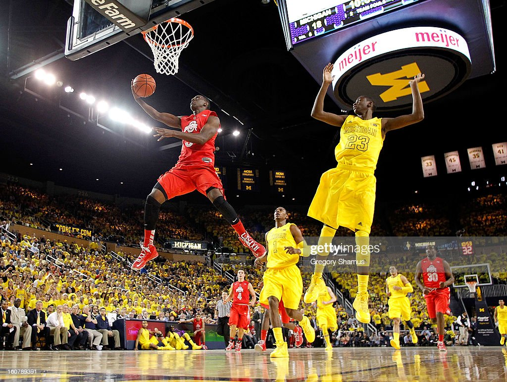 Shannon Scott #3 of the Ohio State Buckeyes gets to the basket in the second half past Caris LeVert #23 of the Michigan Wolverines at Crisler Center on February 5, 2013 in Ann Arbor, Michigan. Michigan won the game 76-74 in overtime.
