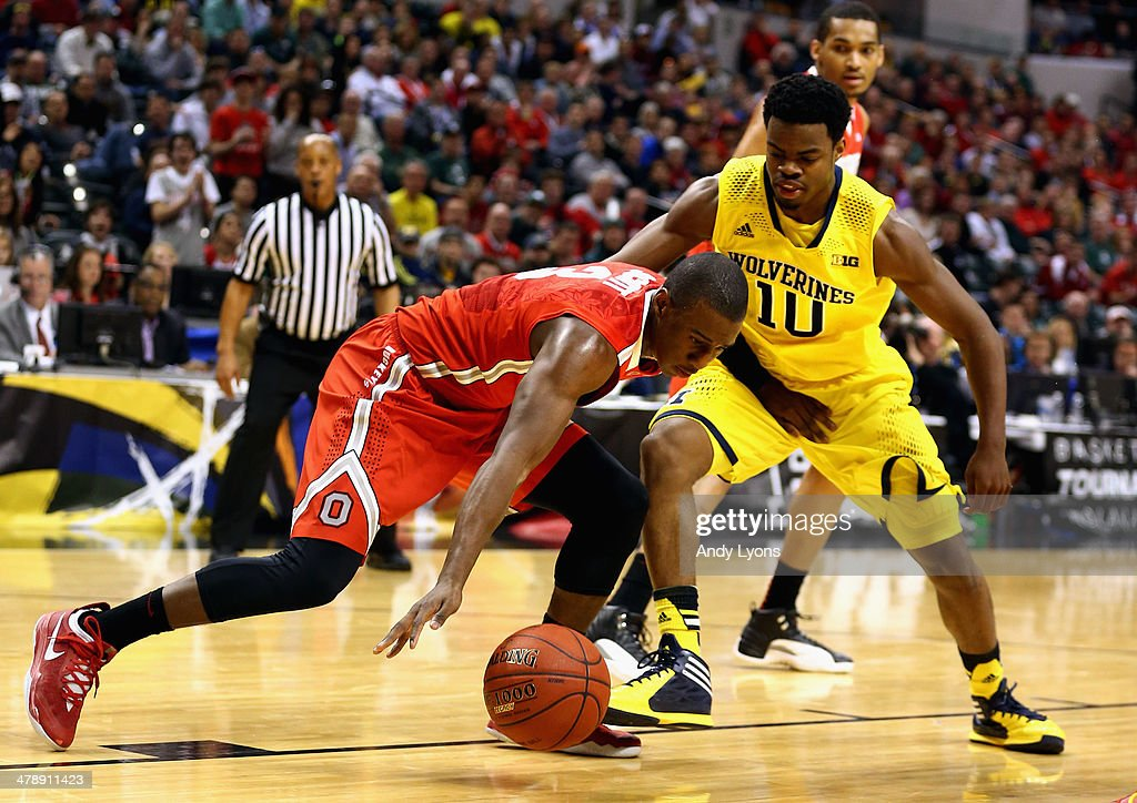 Shannon Scott #3 of the Ohio State Buckeyes tries to keep controls of the ball against Derrick Walton Jr. #10 of the Michigan Wolverines during the first half of the Big Ten Basketball Tournament Semifinal game at Bankers Life Fieldhouse on March 15, 2014 in Indianapolis, Indiana.