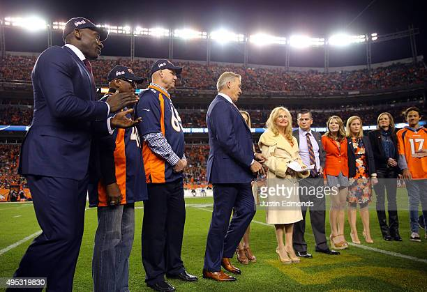 Shannon Sharpe Floyd Little Gary Zimmerman and John Elway present Annabel Bowlen with a ring at the induction of Broncos Owner Pat Bowlen into the...