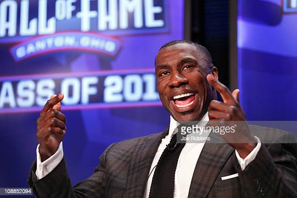 Shannon Sharpe looks on after being inducted into the 2011 Pro Football Hall of Fame class during an announcement at the Super Bowl XLV media center...