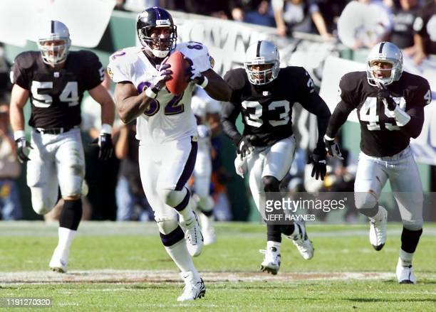 Shannon Sharpe of the Baltimore Ravens outruns Oakland Raiders defenders for a 96yard touchdown reception in the second quarter of their AFC...