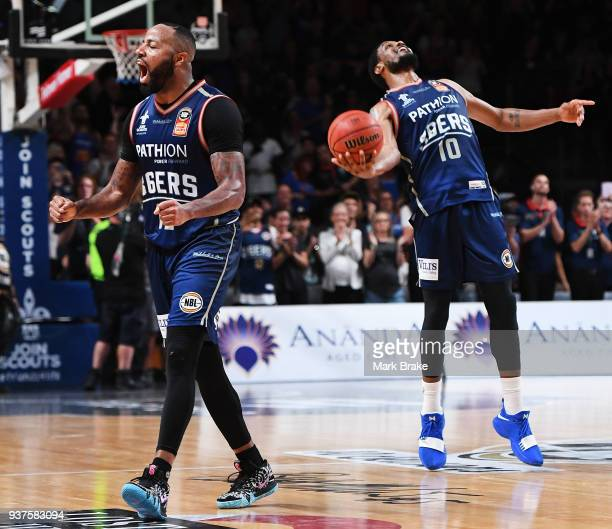 Shannon Shorter cheers and Ramon Moore of the Adelaide 36ers celebrate the final whistle during game four of the NBL Grand Final series between the...