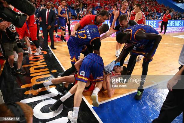 Shannon Shorter Majok Deng and Nelson Larkins of the 36ers wrestle with Clint Steindl of the Wildcats during the round 17 NBL match between the Perth...