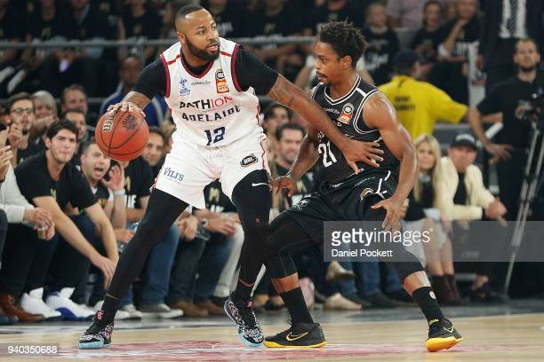 Shannon Shorter of the 36ers and Casper Ware of Melbourne United contest the ball during game five of the NBL Grand Final series between Melbourne...