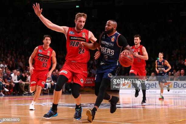 Shannon Shorter of the 36ers brings the ball up the court against Jesse Wagstaff of the Wildcats during game one of the Semi Final series between the...