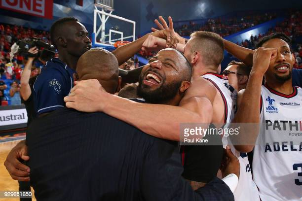 Shannon Shorter of the 36ers celebrates with Joey Wright head coach after winning game two of the NBL Semi Final series between the Adelaide 36ers...