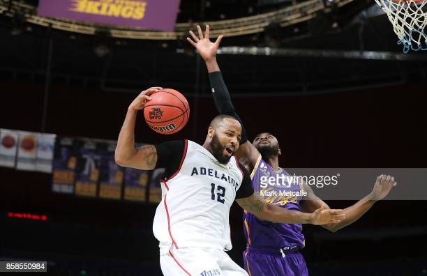 Shannon Shorter of the 36ers wins a rebound ahead of Travis Leslie of the Kings during the round one NBL match between the Sydney Kings and the...