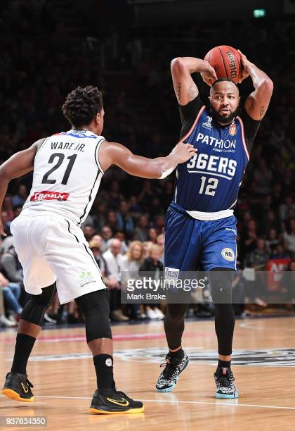 Shannon Shorter of the Adelaide 36ers looks to pass guarded by Casper Ware of Melbourne United during game four of the NBL Grand Final series between...