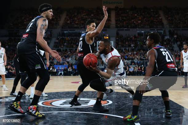 Shannon Shorter of the Adelaide 36ers passes the ball while falling to the ground during the round five NBL match between Melbourne United and the...
