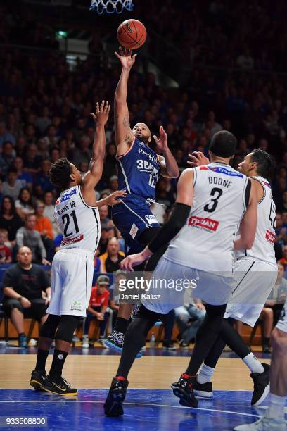 Shannon Shorter of the Adelaide 36ers shoots over Casper Ware of Melbourne United during game two of the NBL Grand Final series between the Adelaide...