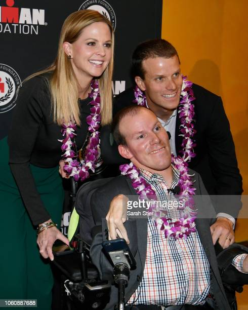 Shannon Spake poses for a photo with Kyle and Brent Pease on the red carpet during the IRONMAN World Championship Broadcast Premiere at the...