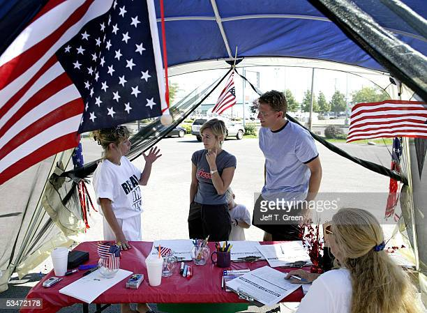 Shannon Sullivan works the booth at Camp Sullivan to explain the recall petition to voters August 27 2005 in Spokane Washington The location will be...