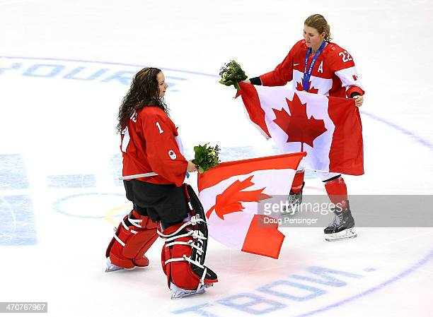 Shannon Szabados and Hayley Wickenheiser of Canada celebrate during the flower ceremony after defeating the United States 32 in overtime during the...
