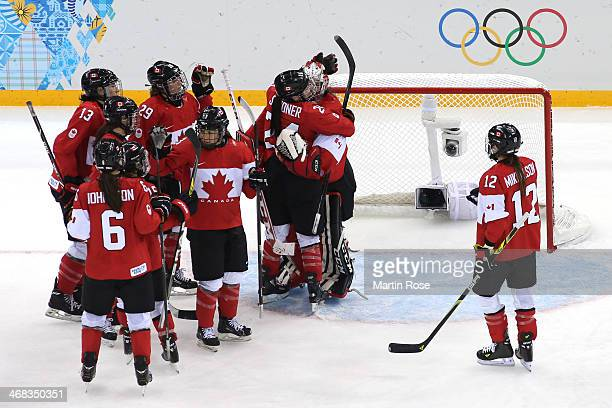 Shannon Szabados of Canada celebrates with teammate Natalie Spooner their 3 to 0 victory over Finland in the Women's Ice Hockey Preliminary Round...