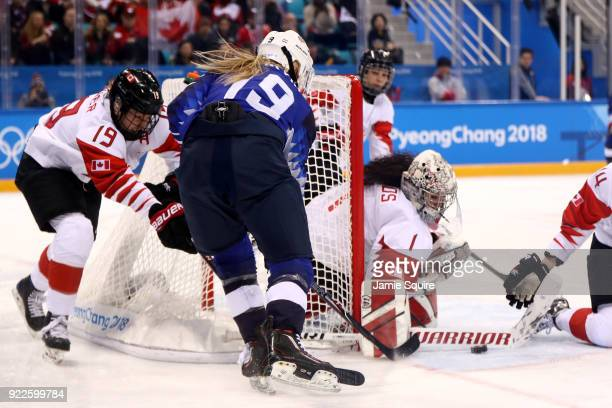 Shannon Szabados of Canada makes a save in the first period against Gigi Marvin of the United States during the Women's Gold Medal Game on day...