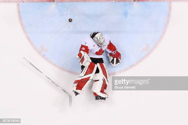 Shannon Szabados of Canada reacts on the ice after allowing a goal to Jocelyne Lamoureux of the United States in the overtime penalty-shot shootout...
