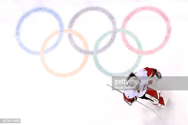 Shannon Szabados of Canada skates past the Olympic Rings in the first period against the United States during the Women's Gold Medal Game on day...