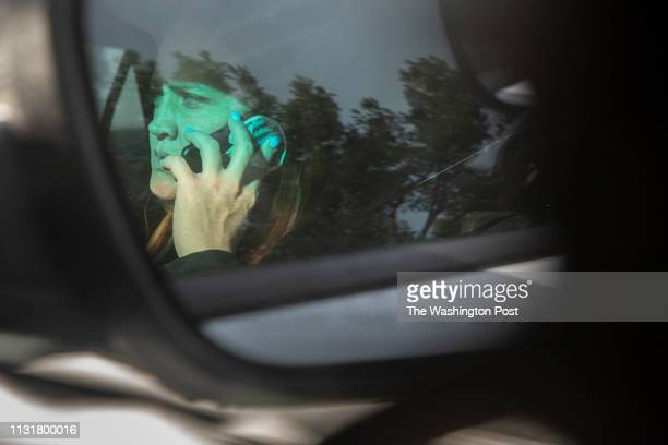 Shannon Teague makes a phone call while her partner Tyrone Anderson drives the two to City of South El Monte Public Safety Center to strategize with...
