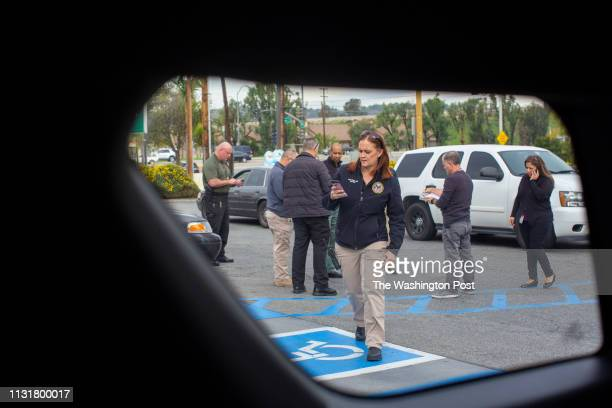Shannon Teague walks to the patrol car during a meeting with the Mental Evaluation Team in a parking lot near a veteran's home whom they are visiting...