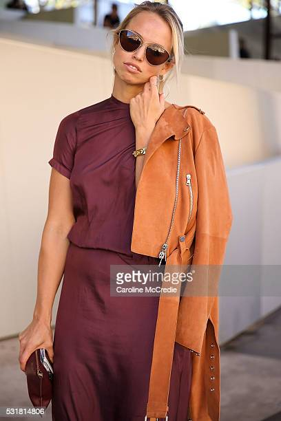 Shannon Thomas wearing Kacey Devlin dress Liven jacket and Celine heels arrives at MercedesBenz Fashion Week Resort 17 Collections at Carriageworks...
