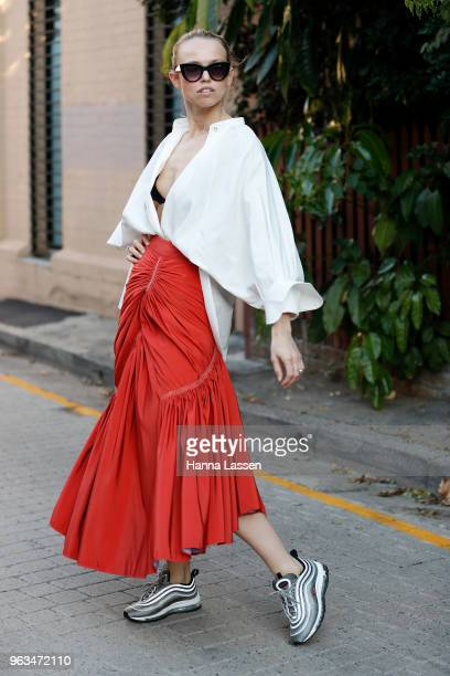 Shannon Thomas wearing Peter Petrov shirt Maticevski skirt and Nike Air Max 97 on May 29 2018 in Sydney Australia