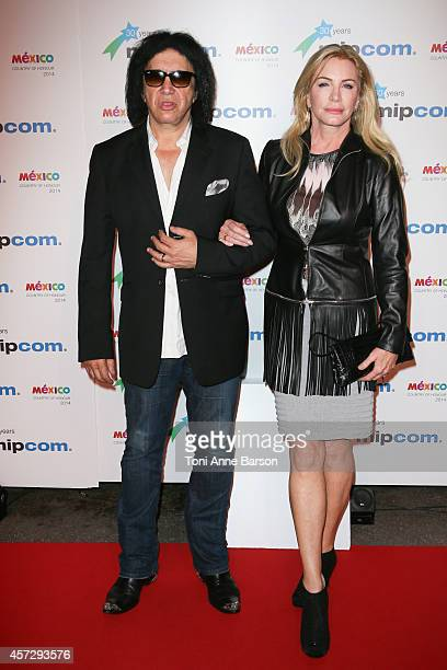 Shannon Tweed and Gene Simmons arrive at the MIPCOM opening Party at Hotel Martinez on October 13 2014 in Cannes France