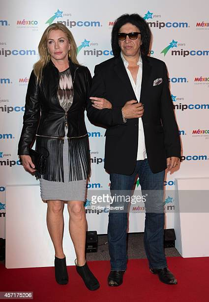 Shannon Tweed and Gene Simmons attend the opening red carpet party MIPCOM 2014 at Hotel Martinez on October 13, 2014 in Cannes, France.