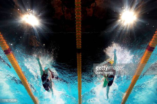 Shannon Vreeland of the USA and Kylie Palmer of Australia compete during the Swimming Women's Freestyle 4x200m Final on day thirteen of the 15th FINA...