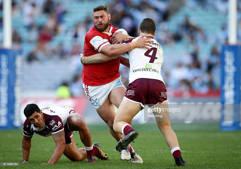 Shannon Wakeman of the Cutters is tackled during the 2016 State Championship Grand Final match between the Illawarra Cutters and the Burleigh Bears at ANZ Stadium on October 2, 2016 in Sydney, Australia.