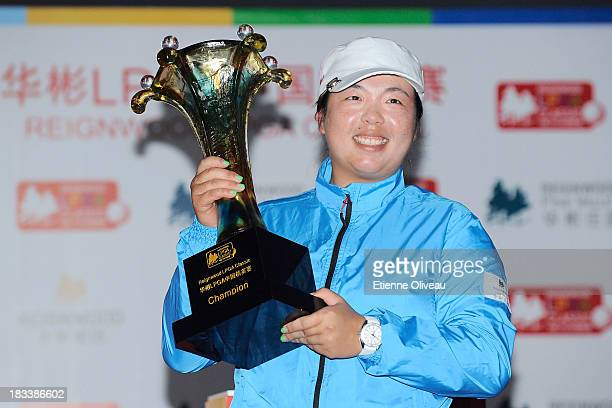 Shanshan Feng holds her trophy during the closing ceremony of the Reignwood LPGA Classic at Pine Valley Golf Club on October 6 2013 in Beijing China