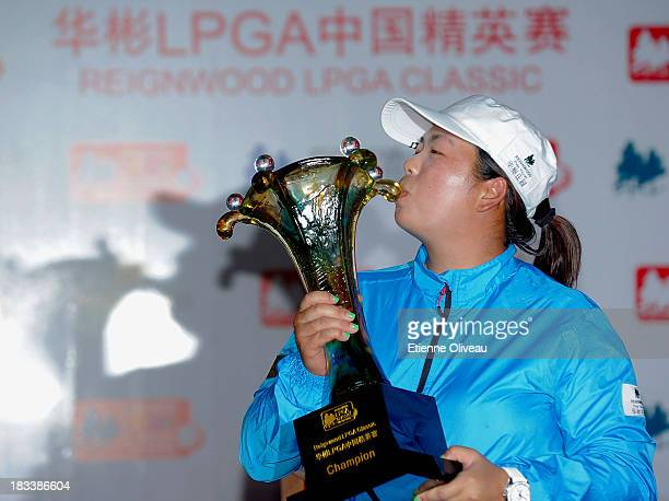 Shanshan Feng kisses her trophy during the closing ceremony of the Reignwood LPGA Classic at Pine Valley Golf Club on October 6 2013 in Beijing China
