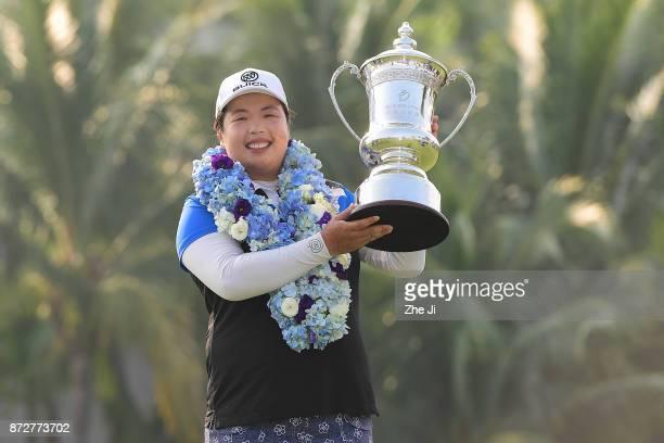 Shanshan Feng of China celebrates after winning the Blue Bay LPGA at Jian Lake Blue Bay golf course on November 10 2017 in Hainan Island China