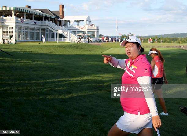Shanshan Feng of China greets the fans as she walks off the 18th green during the US Women's Open round three on July 15 2017 at Trump National Golf...