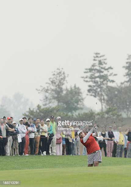 Shanshan Feng of China hits a fairway shot during the final round of the Reignwood LPGA Classic at Pine Valley Golf Club on October 6 2013 in Beijing...