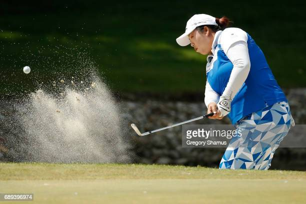 Shanshan Feng of China hits from a green side bunker on the seventh hole during the final round of the LPGA Volvik Championship on May 28 2017 at...