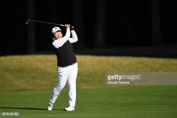 Shanshan Feng of China hits her second shot on the 15th hole during the final round of the TOTO Japan Classics 2017 at the Taiheiyo Club Minori...