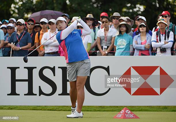 Shanshan Feng of China hits her tee shot on the first hole during the final round of the HSBC Women's Champions at the Sentosa Golf Club on March 8...