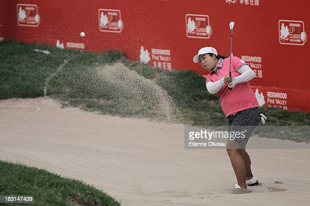 Shanshan Feng of China hits out of a bunker during the third round of the Reignwood LPGA Classic at Pine Valley Golf Club on October 5 2013 in...