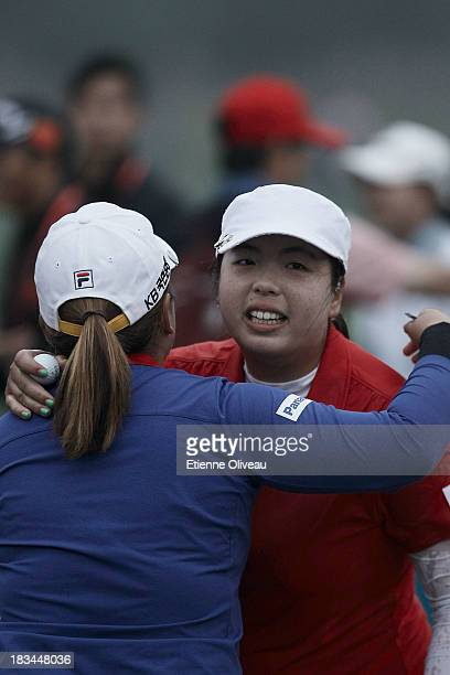 Shanshan Feng of China hugs Inbee Park of South Korea after winning during the final round of the Reignwood LPGA Classic at Pine Valley Golf Club on...