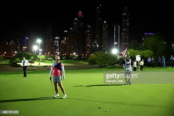 Shanshan Feng of China in action during the Challenge Match on the par 3 floodlit course as a preview for the 2014 Omega Dubai Ladies Masters at...