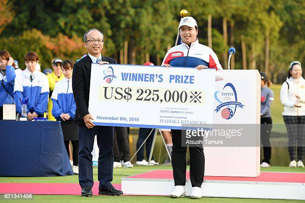Shanshan Feng of China is presented with the winners cheque after winning the TOTO Japan Classics 2016 at the Taiheiyo Club Minori Course on November...