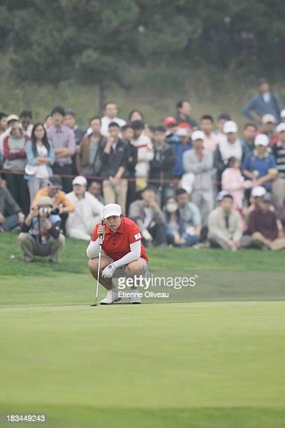 Shanshan Feng of China lines up a putt during the final round of the Reignwood LPGA Classic at Pine Valley Golf Club on October 6 2013 in Beijing...