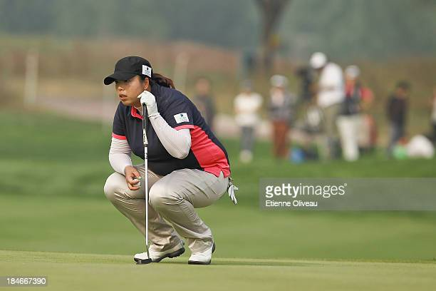 Shanshan Feng of China lines up a putt during the second round of the Reignwood LPGA Classic at Pine Valley Golf Club on October 4 2013 in Beijing...