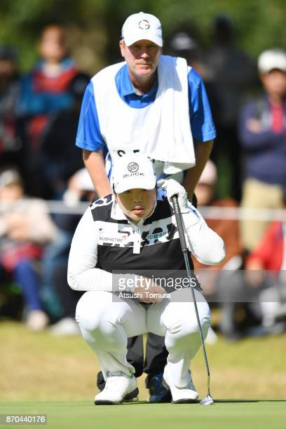 Shanshan Feng of China lines up a putt on the 3rd hole during the final round of the TOTO Japan Classics 2017 at the Taiheiyo Club Minori Course on...