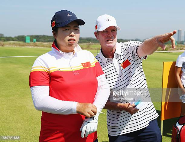 Shanshan Feng of China lines up a shot during a practice round prior to the start of the women's golf during Day 10 of the Rio 2016 Olympic Games at...